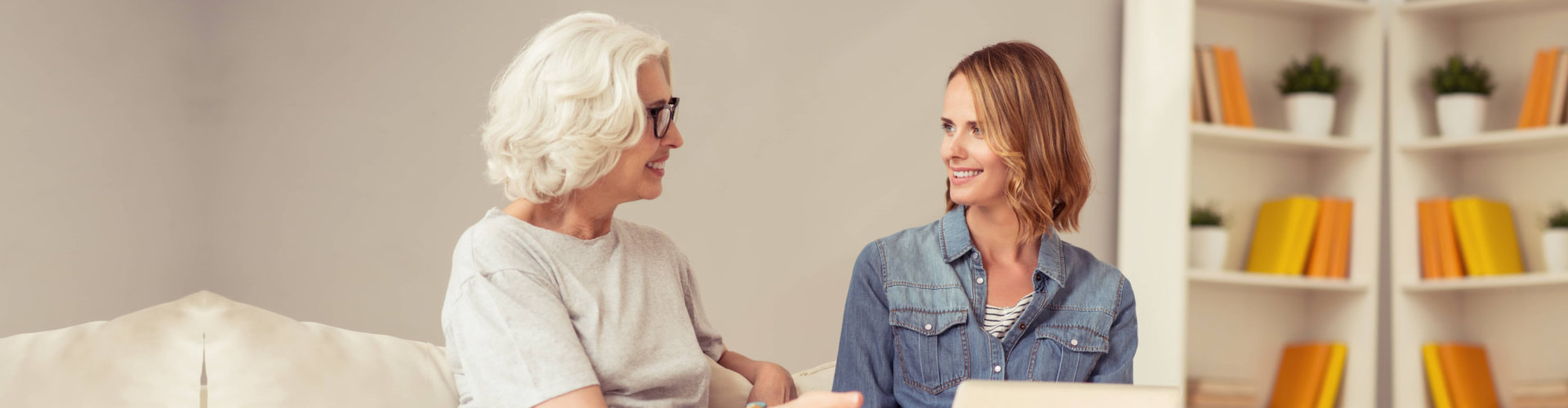 senior woman having conversation with a woman